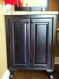 Distressed Bathroom Vanities Bathroom Vanity In Black With Red Distressed Cabinets