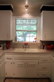 kitchen sink lighting ideas for wall over kitchen sink tiffany