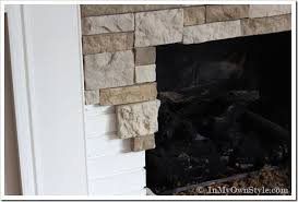 diy stone fireplace makeover would also work under the bar in the