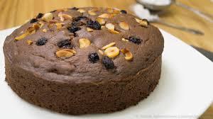 pressure cooker eggless chocolate nuts cake recipe eggless