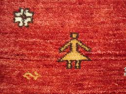 qashqai gabbeh rug in a blue field with madder and yellow corner