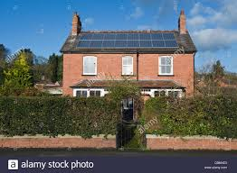 period house solar panels on roof of detached red brick period house in kington