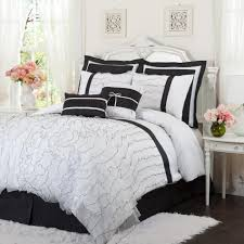 white ruched duvet comforter sets with white black pillows on