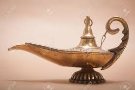 a magic genie lamp isolated on a sand color background in a