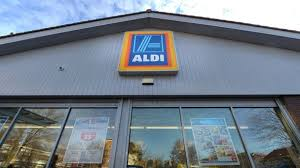 siege social aldi aldi sales race ahead despite profits from investment and