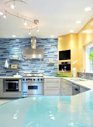 lovely light blue glass tile backspalsh with u shaped brown