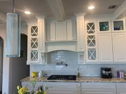 how to clean yellowed white kitchen cabinets my white kitchen cabinets above the range are starting to