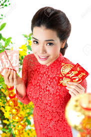 tet envelopes girl showing envelopes with money for tet