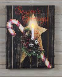 lighted canvas art with timer shelley b home and holiday candy cane and star season s greeting