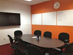 Modern Conference Room Design by Rustic Unpolished Teak Wood Meeting Table And Black Acrylic