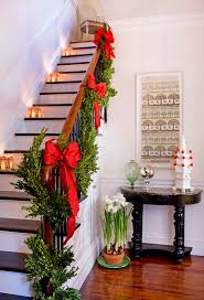 How To Decorate A Swag For Christmas Festive Holiday Staircases And Entryways Traditional Home