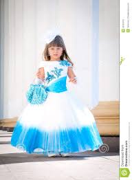 little bride a in a lush white and blue wedding dress stock