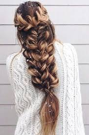 pintrest hair picture of a large voluminous braid made of several braids on long