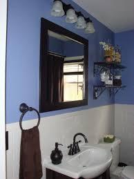 blue bathroom wall paint including black iron bathroom shelving