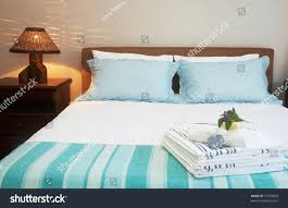 beautiful bedroom interior white sheets striped stock photo