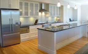 a modern touch is attained with a subtle glass splashback and