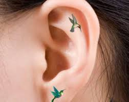 nice women tattoo tiny hummingbird tattoo ear google search