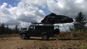 land rover discovery camping camping in a hannibal roof tent on a landrover defender with a