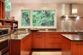 metal backsplash as stylish design idea for kitchen interior fresh eco designed kitchen with mirroring steel surface of the backsplash