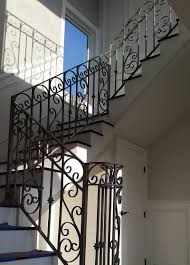 orange iron fencing entry driveway property gates folding