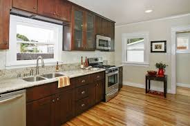 traditional kitchen with flat panel cabinets crown molding in