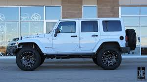 lifted jeep blue kc trends showcase xd heist black milled wheels mounted with