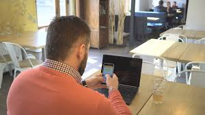 L K He Middle Aged Man With Tattoos And Beard Enjoys A Smartphone Sms
