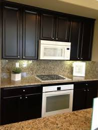 Black And White Appliance Reno Dark Kitchen Cabinets And White Appliances Not Bad For The