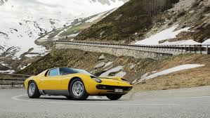 golden lamborghini lamborghini celebrates miura u0027s 50th anniversary with scenic drive
