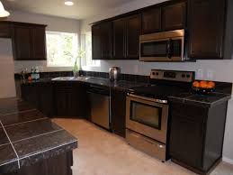 decorations black granite countertop and beige tile backsplash