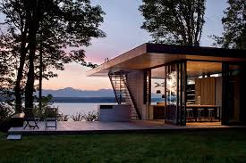 architecture chic evening outside lake house residence showing