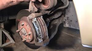 how to change front brake pads in 10 minutes mazda protege