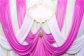 wedding backdrop background white and pink curtain backdrop background for wedding stock photo