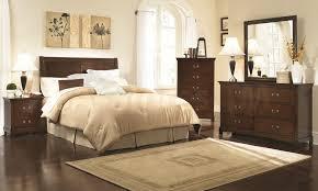 dark brown wooden bedroom dresser added by cream bedding set on