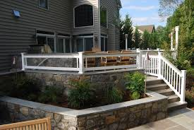 multi tier patio and deck project with outdoor kitchen stone