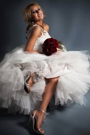wedding dress one shoulder with full tulle skirt bride holds
