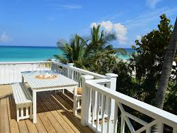 sunny apartment overlooking pink sand beach vrbo