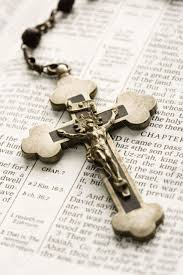 rosary crucifixes crucifix on rosary lying on open bible stock photo picture and