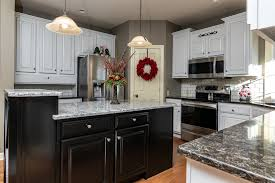 kitchen with black island and white cabinets top 5 kitchen cabinet transformations from 2019 garrett