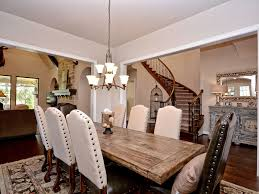 cottage dining room with hardwood floors u0026 chandelier in austin