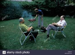 group 3 three adults family backyard bbq barbecue cook out food