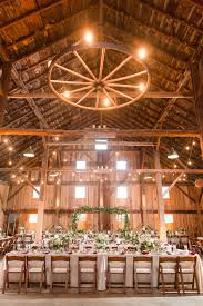 rustic wedding reception decor idea barn venue with high ceiling