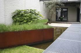 modern landscape architecture angled large corten planter