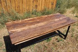 hand crafted reclaimed barnwood table with pipe legs by urban