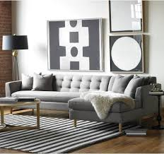 light grey tufted sectional fur throw tall lamp on side opposite