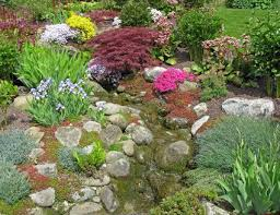 How To Landscape A Sloped Backyard - how to build rock gardens photo tutorial