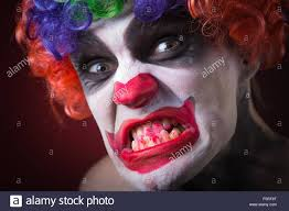 halloween clown background evil spooky clown portrait on dark background expressive man