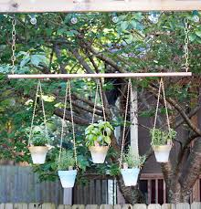 Hanging Plants For Patio Colorful Updates To A Flower Filled Outdoor Living Room