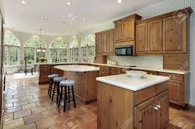 large kitchen with two islands in luxury home stock photo picture