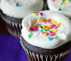 chocolate surprise cupcakes with eggnog white chocolate frosting
